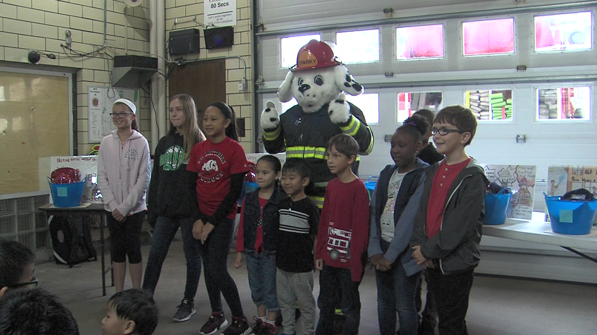 Student winners of MFD's 'Poster to Billboard' contest treated to pizza lunch at firehouse
