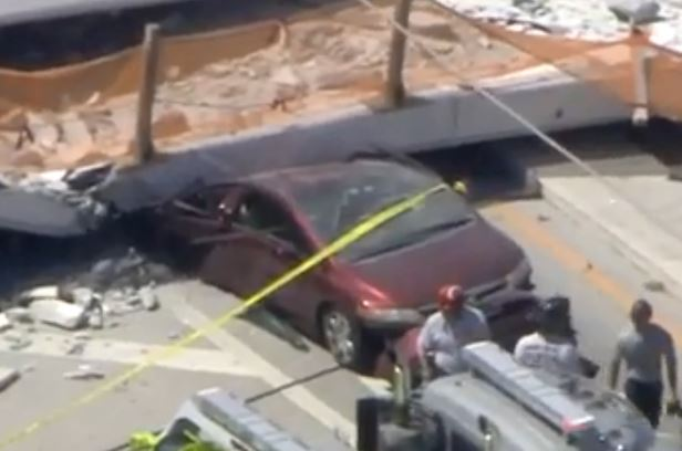 A car trapped underneath a collapsed pedestrian bridge at Florida International University on March 15, 2018.  by WFOR