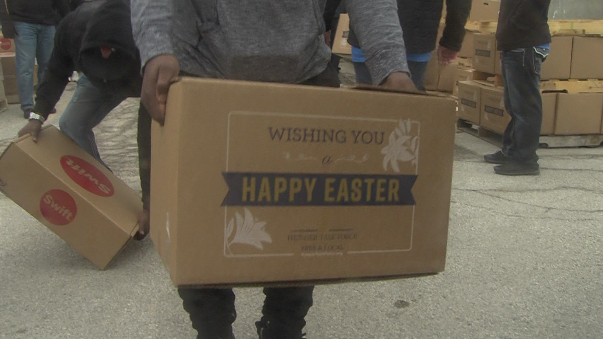 Volunteers pack Easter dinner boxes