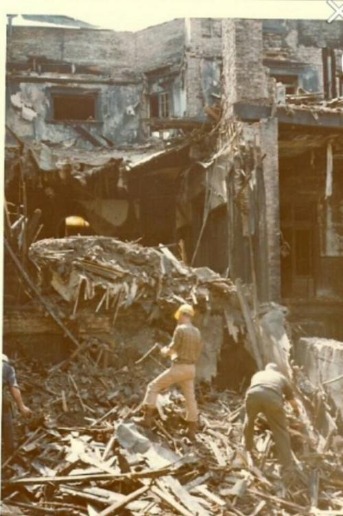 by The Beiger Mansion after the fire in 1975. (Photo courtesy the Beiger Mansion)