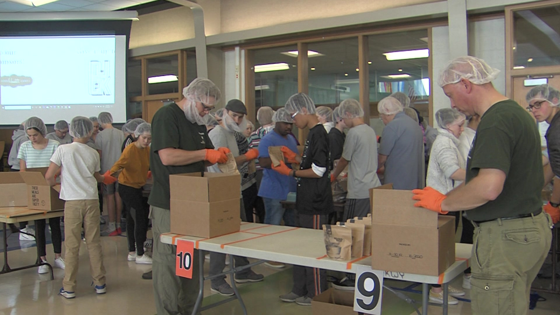 Over 300 volunteers pack 12,000 meals to help fight hunger locally