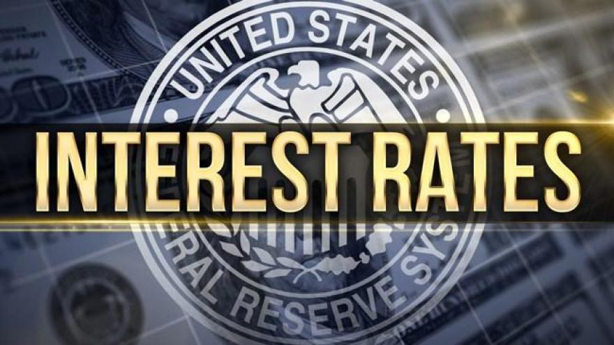 Federal Reserve raises interest rates and signals more hikes