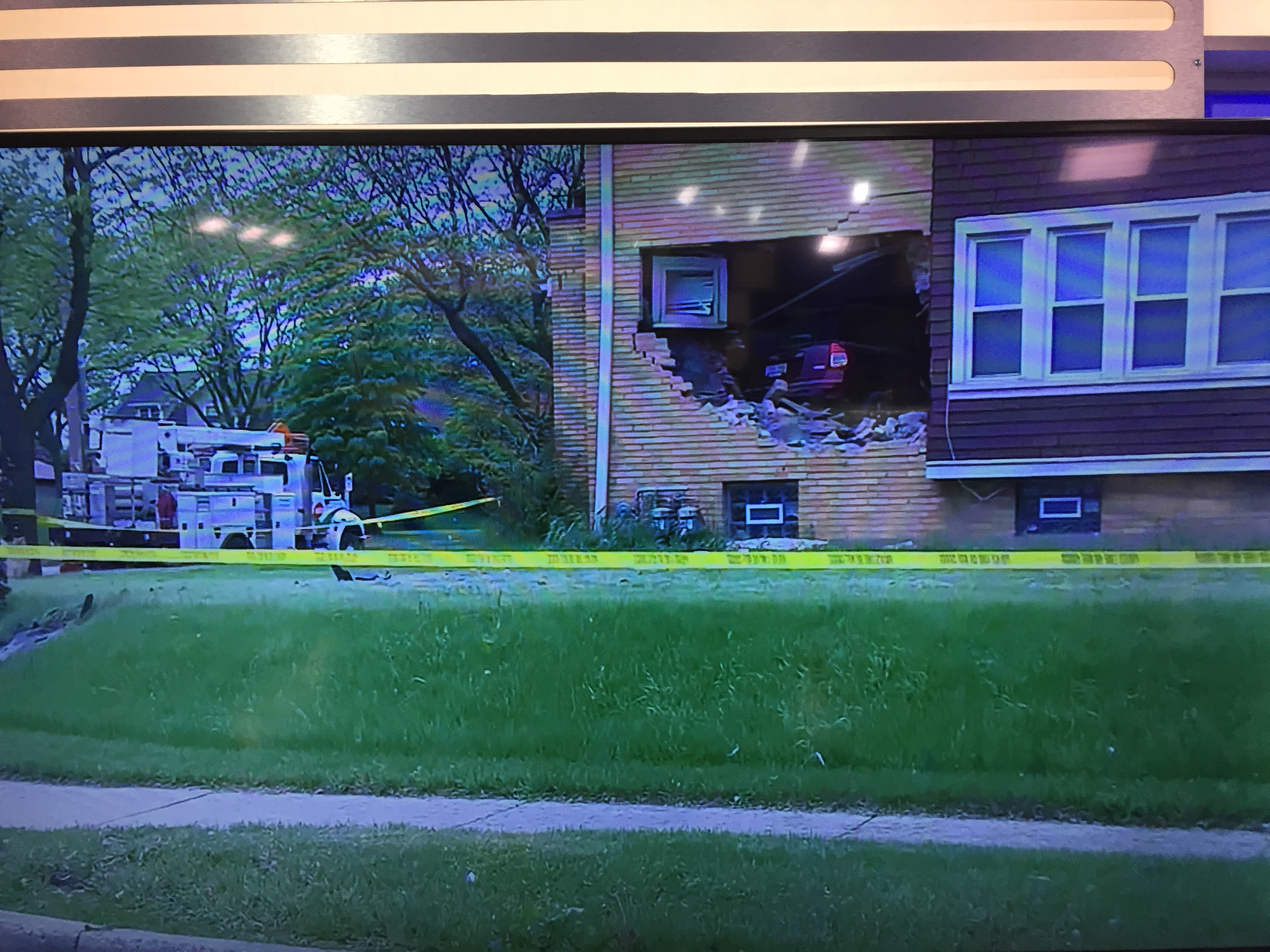 Milwaukee Car Crashes In House